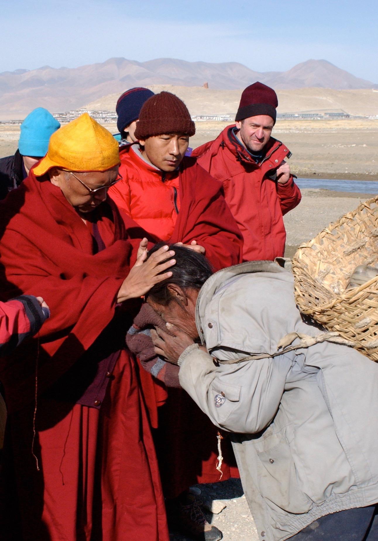 Blessing a farmer in Tingri, Tibet 2002. (Photo Bob Cayton)