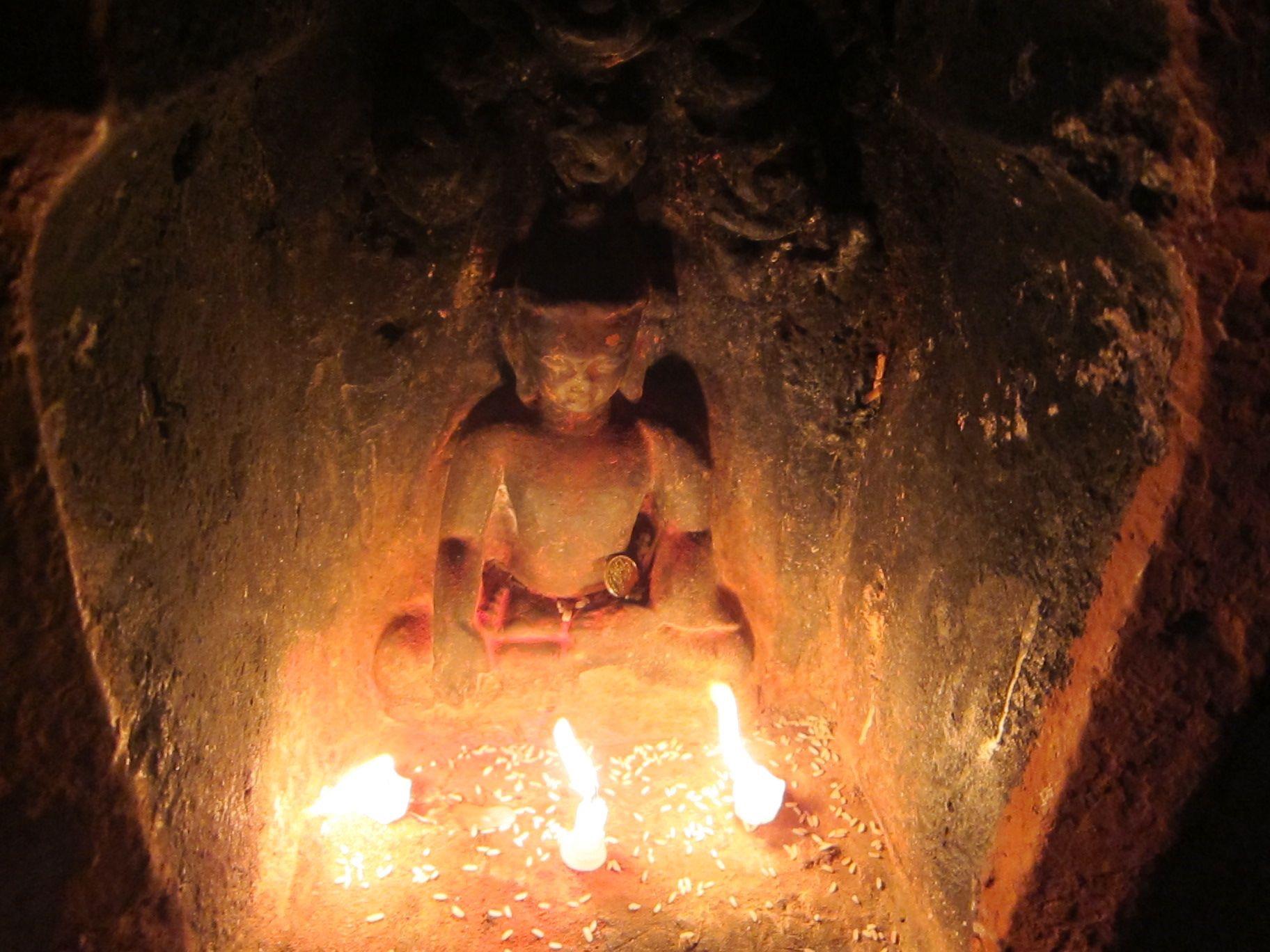Dying candles illuminate a Buddha image at theBoudha stupa, Nepal. (Photo Ven Sarah Thresher)