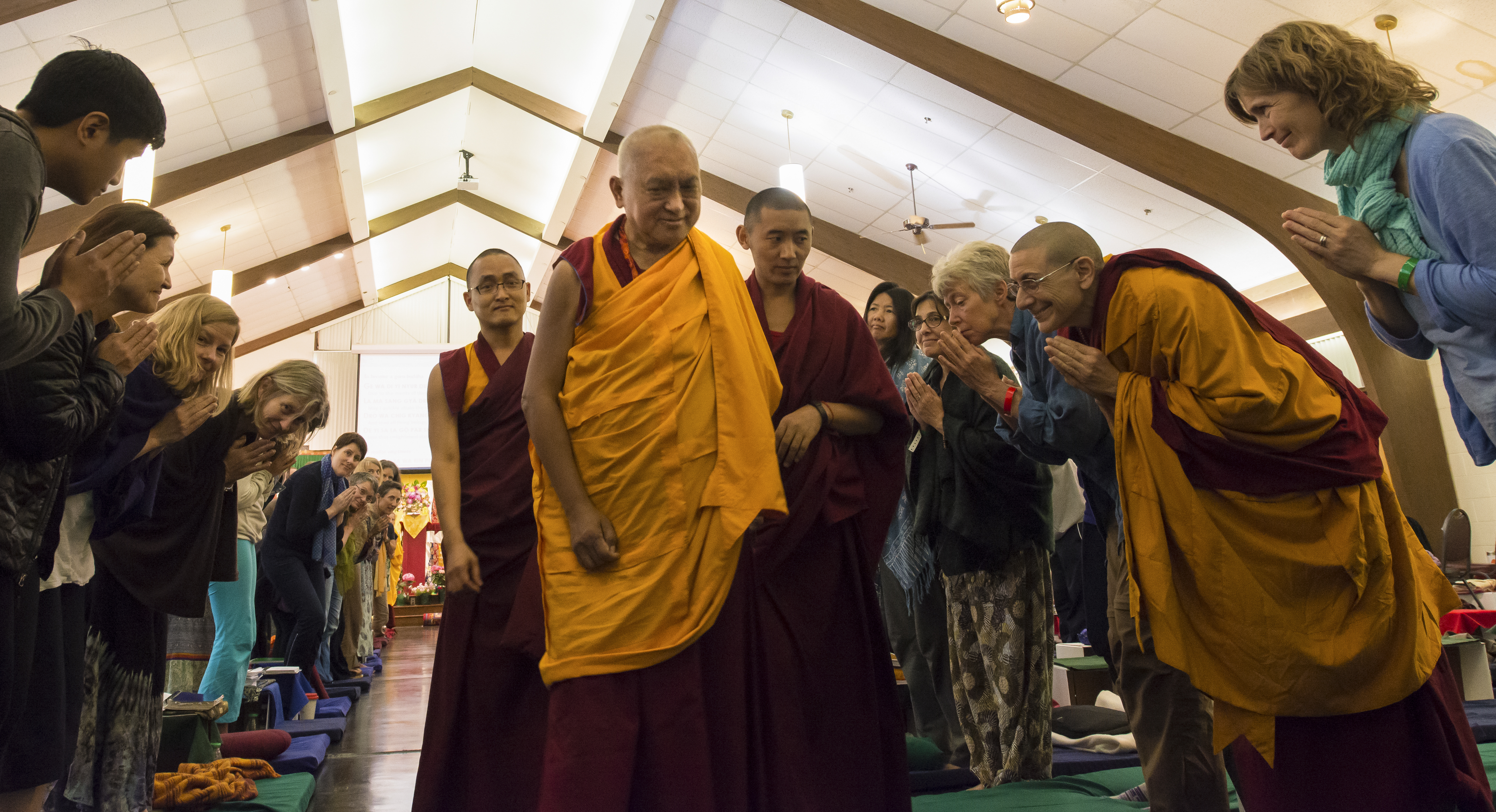 Rinpoche entering the venueat Light of the Path 2014. (Photo Roy Harvey)