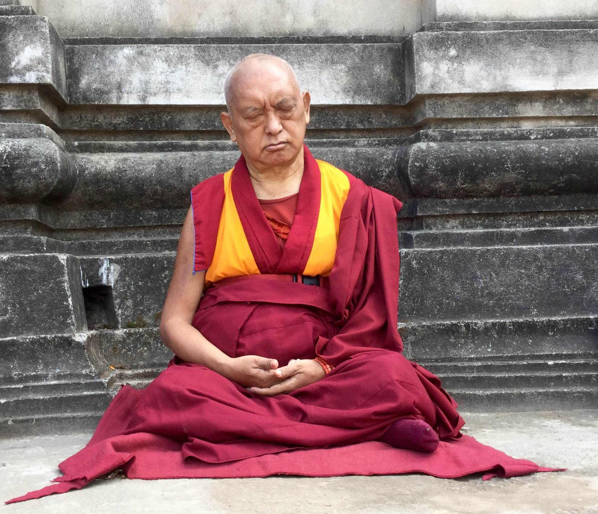 Lama Zopa Rinpoche meditating at the Mahabodhi Stupa in Bodhgaya, 2015. (Photo Ven Sarah Thresher)
