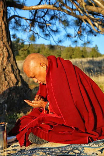 Lama Zopa Rinpoche blessing ants in Washington. Rinpoche has written a special practice for making Charity to Ants. (Photo Ven RogerKunsang)