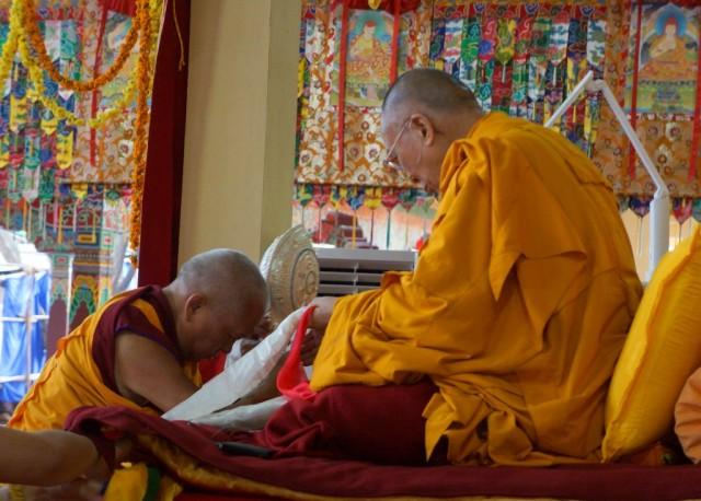 Lama Zopa Rinpoche offering Dharma wheel to His Holiness the Dalai Lama, Jangchub Lamrim teachings, India, 2014. (Photo Bill Kane)