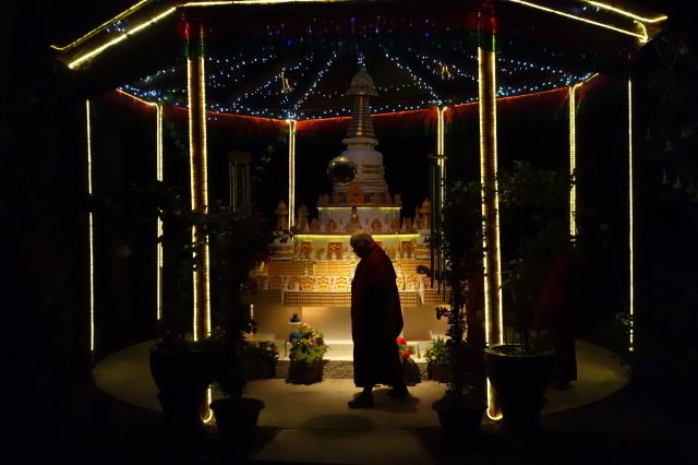 Lama Zopa Rinpoche circumambulatesthe stupa at Khachoe Dechen Ling, California,late at night. Rinpoche's ability to go withoutsleep is legendary.(Photo Ven Roger Kunsang)