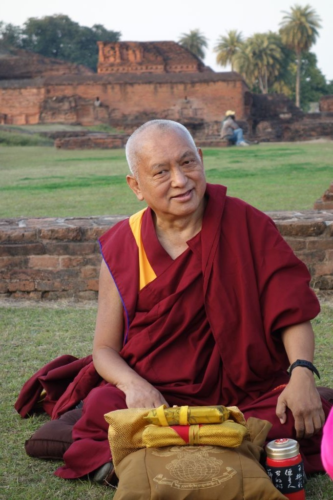 Lama Zopa Rinpoche teaching in the ruins of Nalanda Monastery, oncethe largest monastic university of the ancient world. (Photo Ven Roger Kunsang)