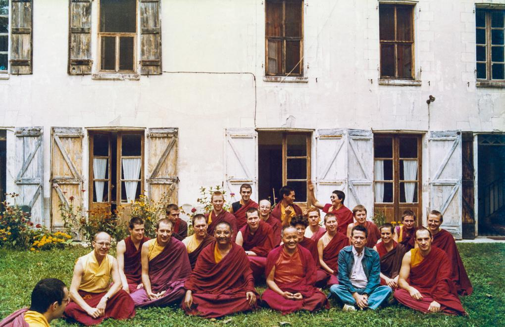 International Mahayana Institute Sangha, Nalanda Monastery, Lavaur, France, 1983. Photo includes Adrian Feldmann (Thubten Gyatso), Chodron Thubten (Cherry Greene), Dieter Kratzer, Lama Yeshe, Merry Colony, Sangye Khadro (Kathleen McDonald), Geshe Jampa Tegchok. Included in the photo a local priest, Father Bastiani, wearing blue.