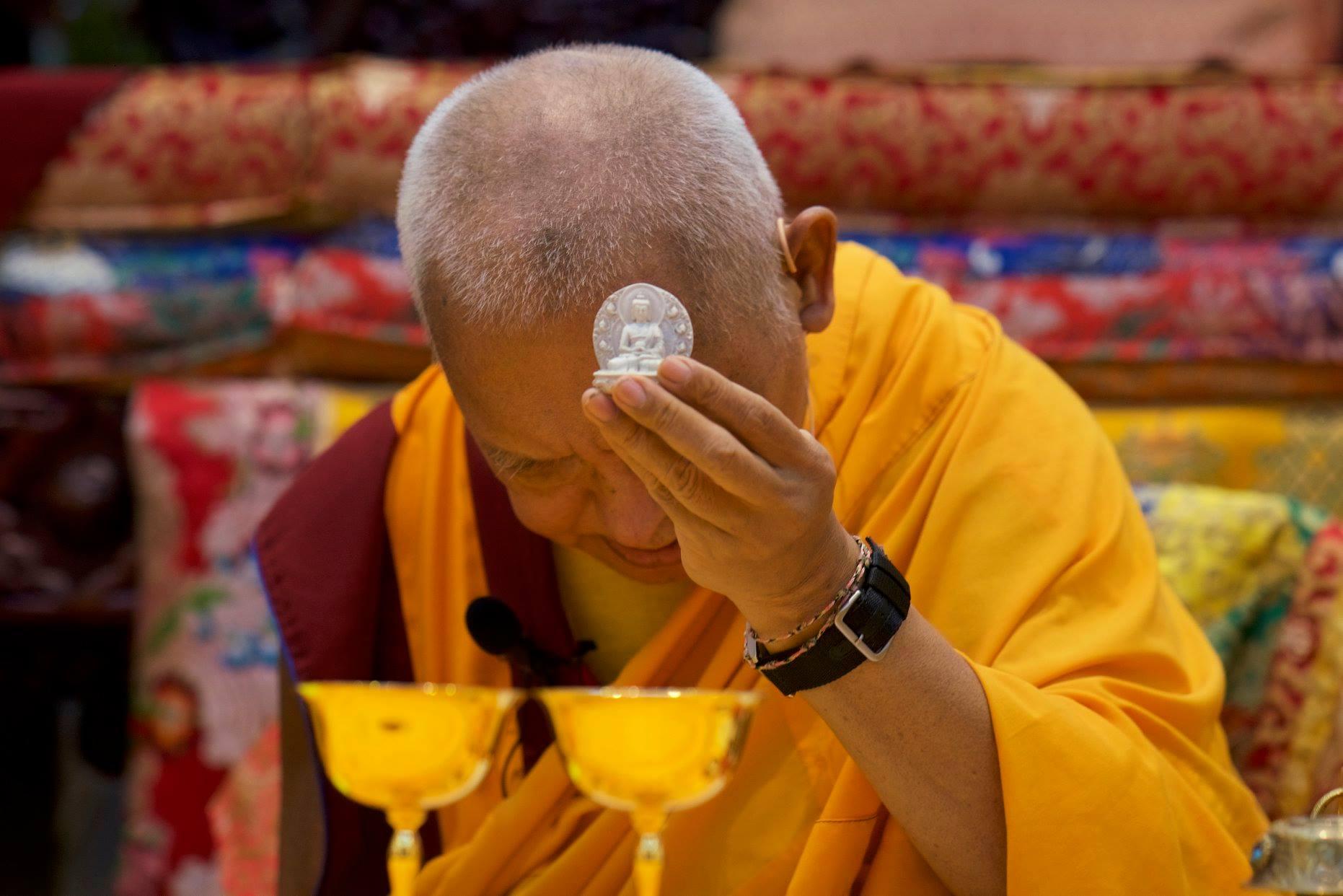 Lama Zopa Rinpoche bestowing Amitabha Pure Land blessing at Amitabha Buddhist Centre, Singapore, October 2018. (Photo Bill Kane)