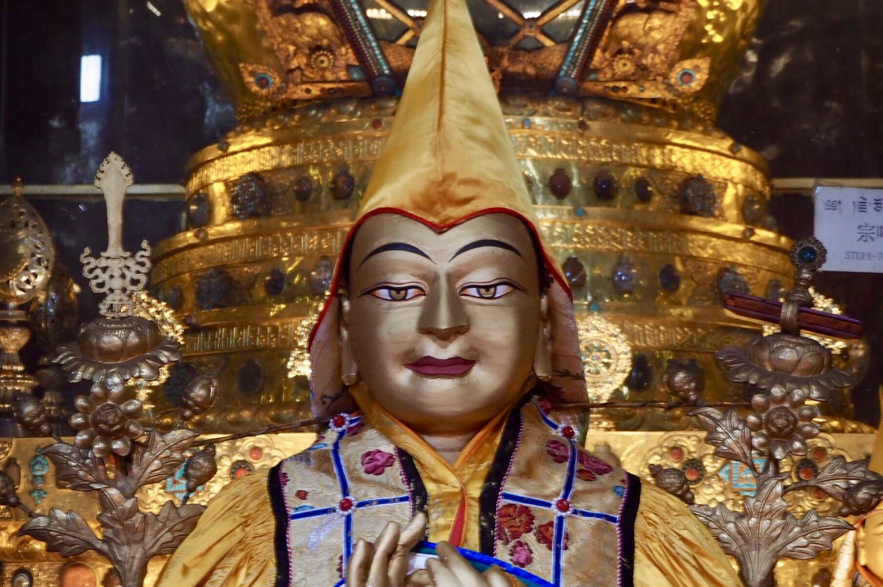 Statue of Lama Tsongkhapa atGanden Monastery, Tibet, in front of the stupa containing his relics.(Photo Ven Tenzin Tsultrim)