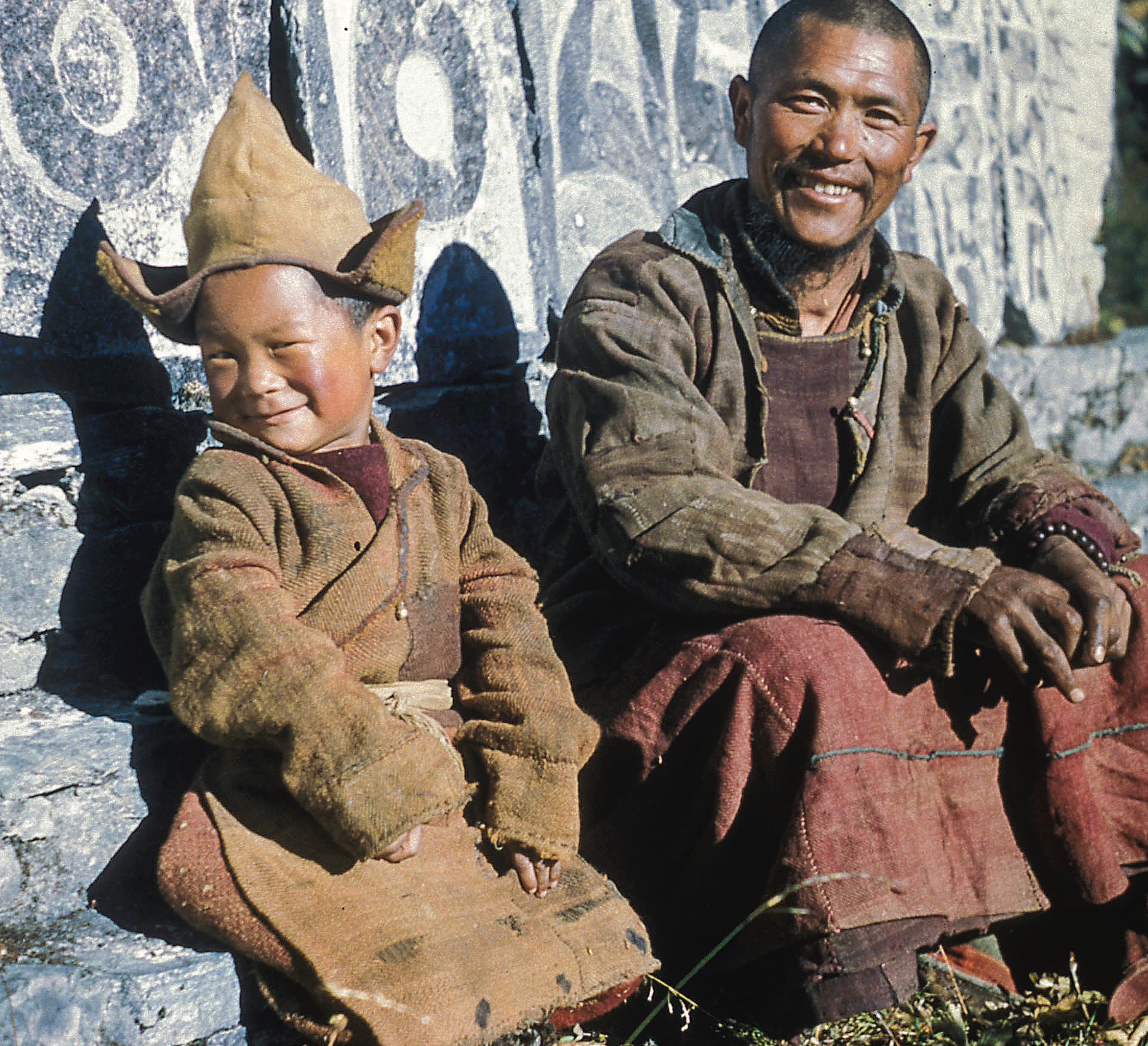 A young Lama Zopa Rinpoche in Solu Khumbu sitting next to his first teacher, Aku Lekshe, who taught Rinpoche the alphabet. (Photo Thomas Weir)