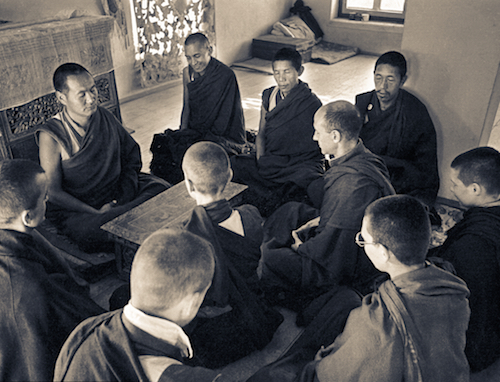 Lama Yeshe, Lama Zopa Rinpoche, Lama Lhundrup, and Lama Pasang with new monastics including Nick Ribush and Yeshe Khadro (Marie Obst) in the gompa (shrine room) at Kopan Monastery, Nepal, 1974.(Photographer unknown)