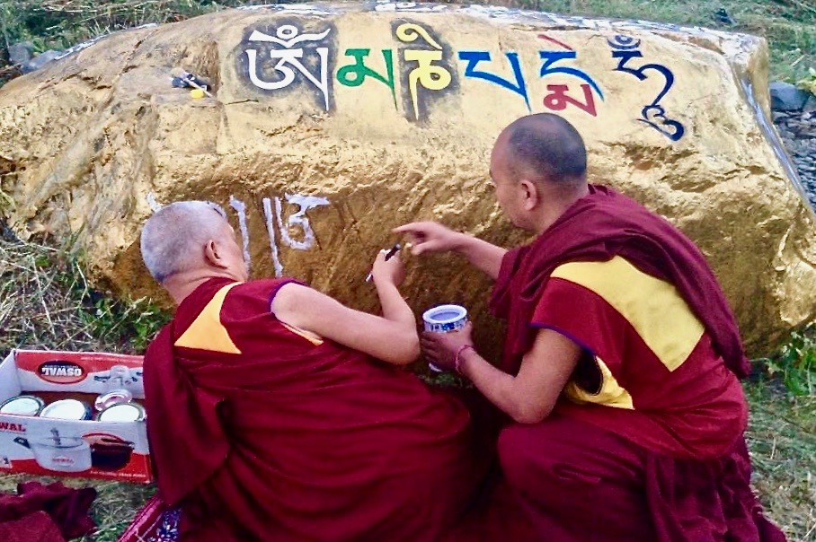 Lama Zopa Rinpoche paints mantra on a rock in Garsha Phakpa, Lahul, India, 2015. (Photo Ven Sangpo)