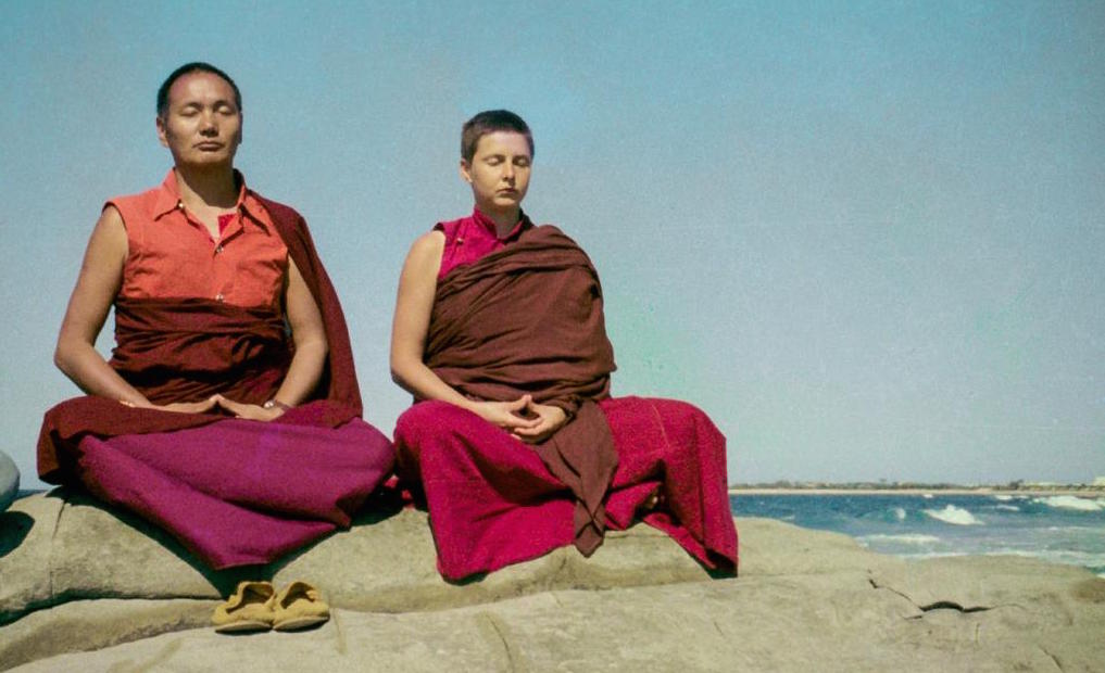 Lama and Yeshe Khadro meditating by the ocean in Australia, 1974. (Photographer unknown)