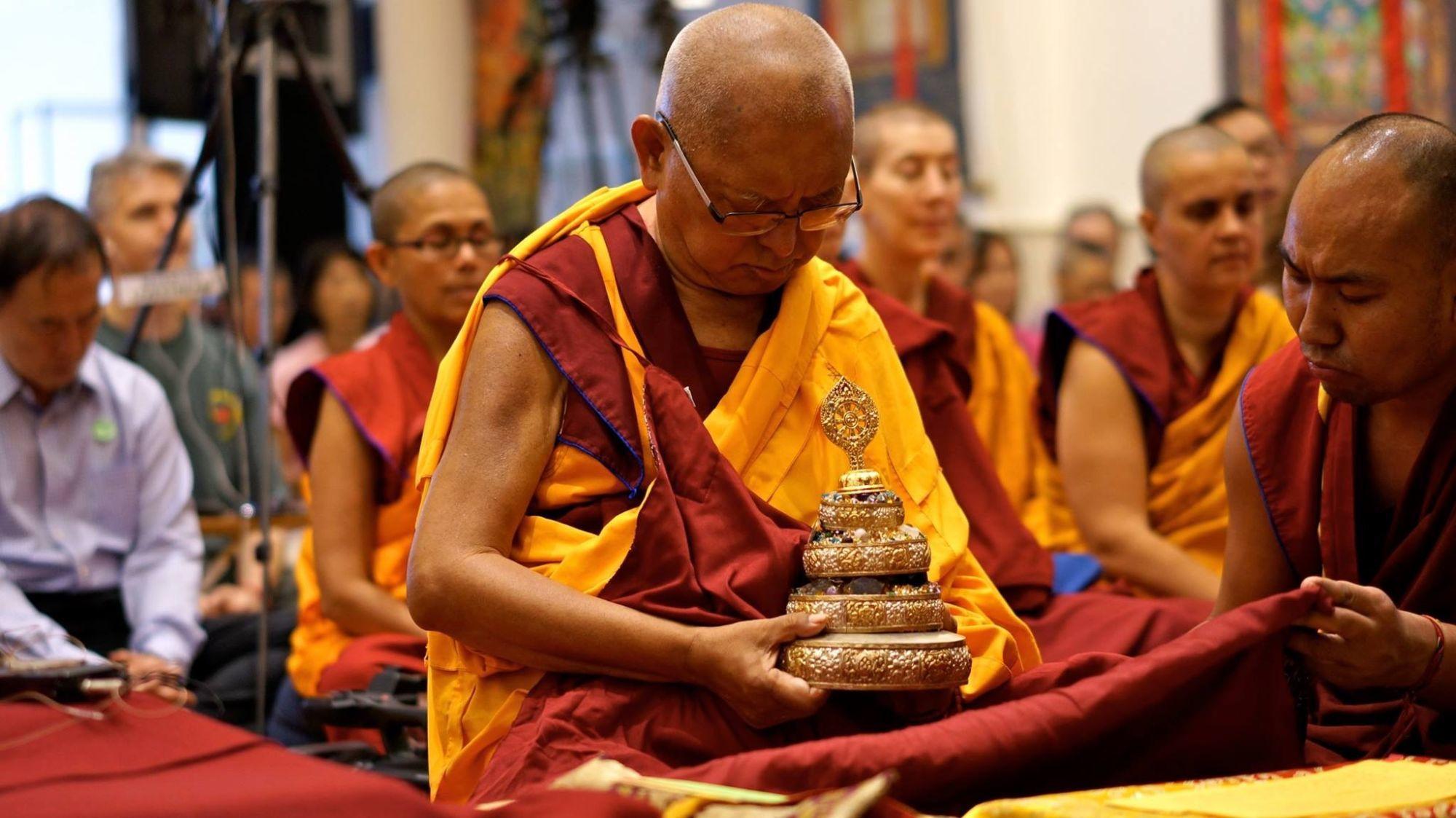 Lama Zopa Rinpoche offering a mandala, ABC, Singapore, 2016. (Photo Bill Kane)