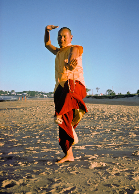 Lama Yeshe dancing/debating on the beach after the month-long course at Chenrezig Institute, Australia, 1975. (Photo by Anila Ann)