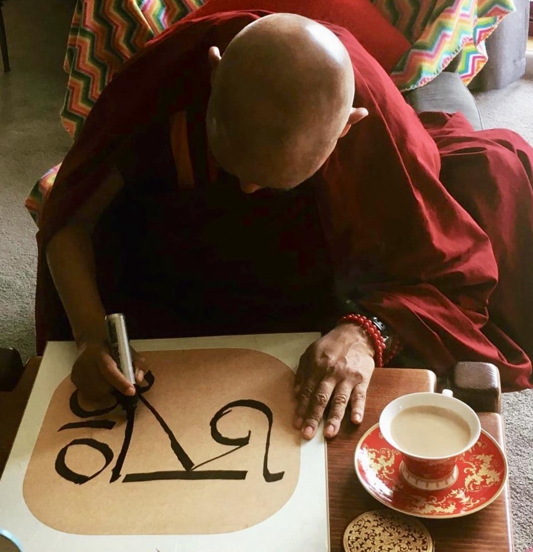 Lama Zopa Rinpoche drawing the syllable AH, 2018. (Photo Ven Roger Kunsang)