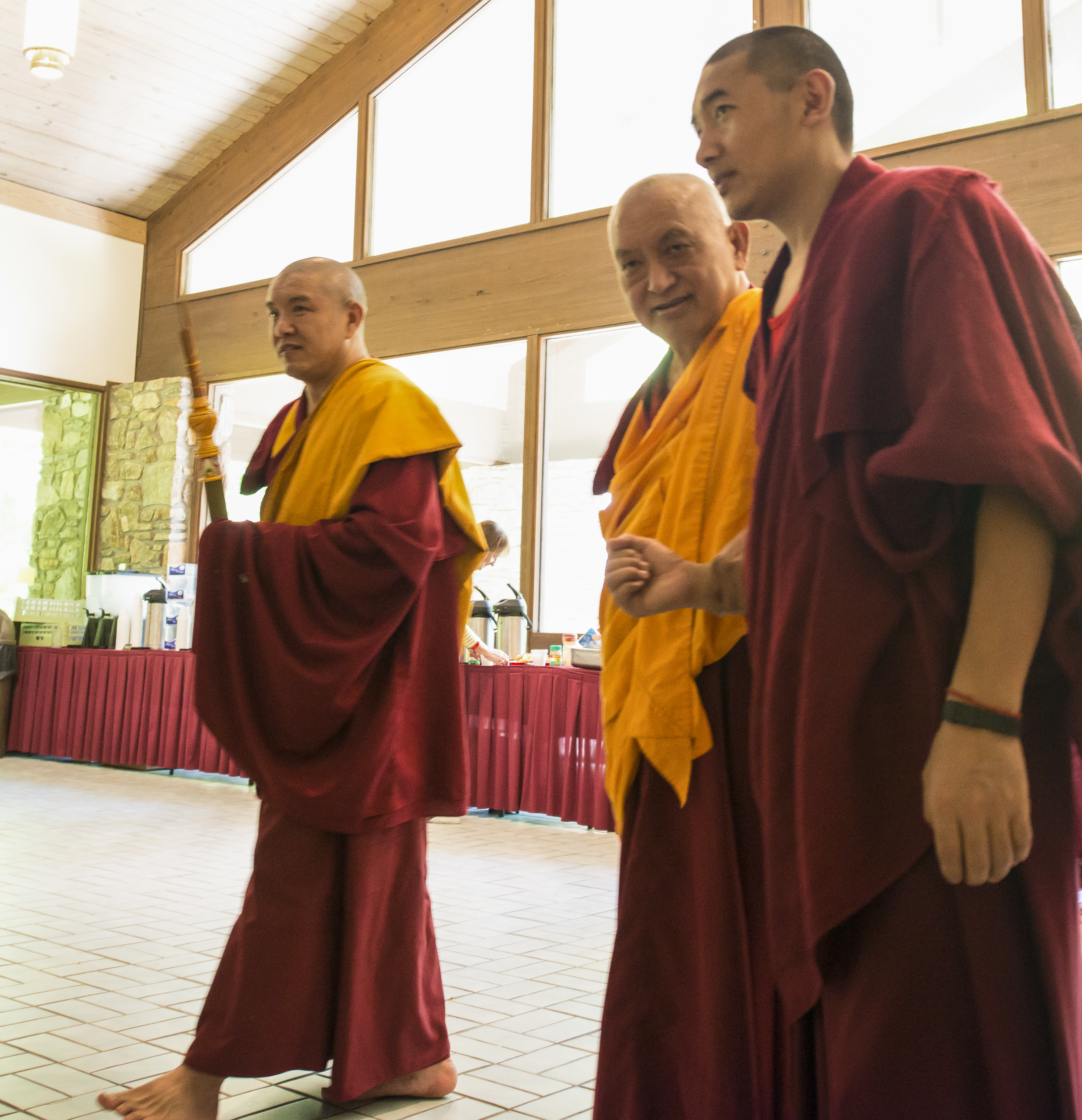 Rinpoche entering the foyer at Light of the Path 2014. (Photo Roy Harvey)